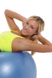 Young woman working out with a ball Stock Image