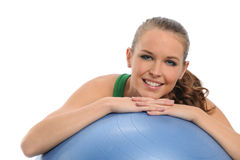 Young Woman working out with a ball Royalty Free Stock Image