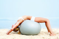 Young woman working out  on the beach Royalty Free Stock Image