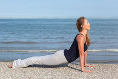 Young woman working out on the beach Royalty Free Stock Images