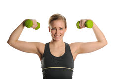 Young Woman working out with bumbbells Stock Image