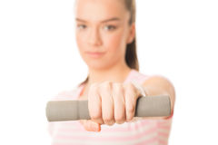 Young woman working out with dumbbells Stock Image