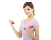 Young woman working out with dumbbells in her hands Royalty Free Stock Photo