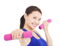 Young woman working out with dumbbells in her hands Royalty Free Stock Image
