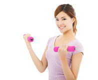 Young woman working out with dumbbells isolated on white Stock Image