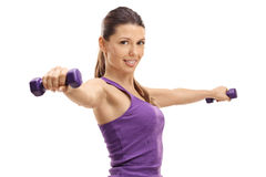 Young woman working out with dumbbells Royalty Free Stock Photos