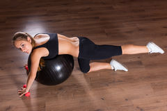 Young Woman Working Out with Exercise Ball Stock Photo