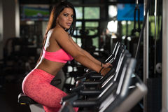 Young Woman Working Out On Exercise Bike Royalty Free Stock Photo