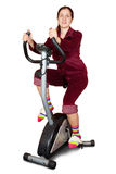 Young woman working out on exercycle Stock Photos