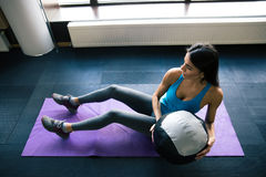 Young woman working out with fit ball Stock Images