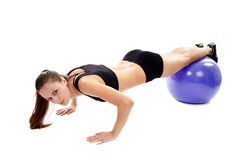 Young woman working out with the fitball Stock Photography