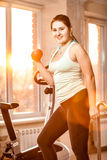 Young woman working out at fitness club Royalty Free Stock Images