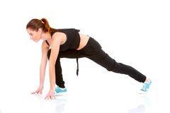 Young woman working out at a gym Royalty Free Stock Photo