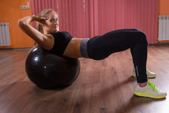 Young woman working out in a gym Royalty Free Stock Image