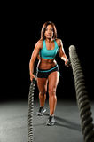 Young Woman Working Out with Hеavy Ropes Stock Image