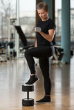 Young Woman Working Out In A Health Club Royalty Free Stock Photos