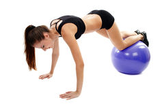 Young woman working out her abs Stock Images