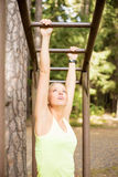 Young woman working out on the ladder Stock Photography