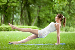 Young woman working out in nature Stock Images