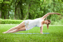 Young woman working out in nature Stock Image