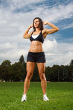 Young woman working out in a park Royalty Free Stock Image