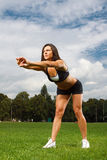 Young woman working out in a park Royalty Free Stock Photography