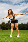 Young woman working out in a park Royalty Free Stock Photos
