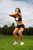 Young woman working out in a park Stock Images