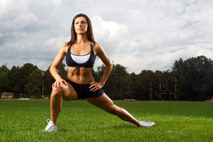 Young woman working out in a park Stock Photos