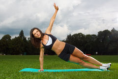 Young woman working out in a park Stock Photo