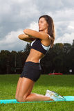 Young woman working out in a park stock image