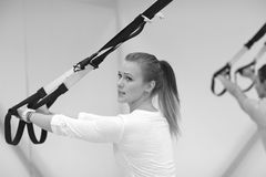 Young woman working out with resistant band, monochrome Stock Photos