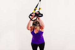 Young woman working out with straps Stock Photos