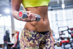 Young woman working out with two dumbbells Stock Images
