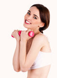 Young woman working out with weights Stock Image
