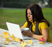 Young woman working outdoors Stock Photos