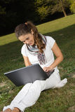 Young woman working in park Royalty Free Stock Images