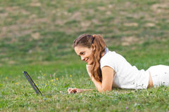 Young woman working  in park Stock Images