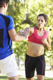 Young Woman Working With Personal Trainer In Park Stock Images