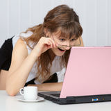 Young woman working with pink  laptop Stock Images