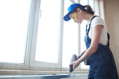 Young Woman Working with Power Drill Royalty Free Stock Photos
