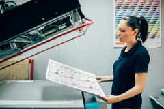 Young woman working in printing factory royalty free stock photo