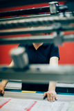 Young woman working in printing factory royalty free stock photography