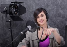 Young woman working on the radio royalty free stock image