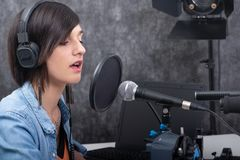 Young woman working on the radio stock photography