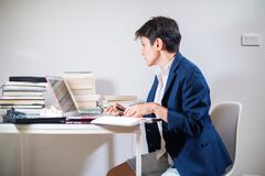 Young woman is working remotely at home