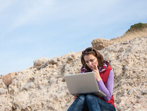 Young woman working on a rock Royalty Free Stock Photography