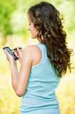 Young woman working with smartphone Stock Image
