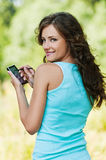 Young woman working with smartphone Royalty Free Stock Image