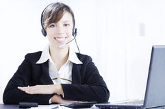 Young woman working and smiling Stock Images